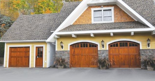 House with wood garage doors